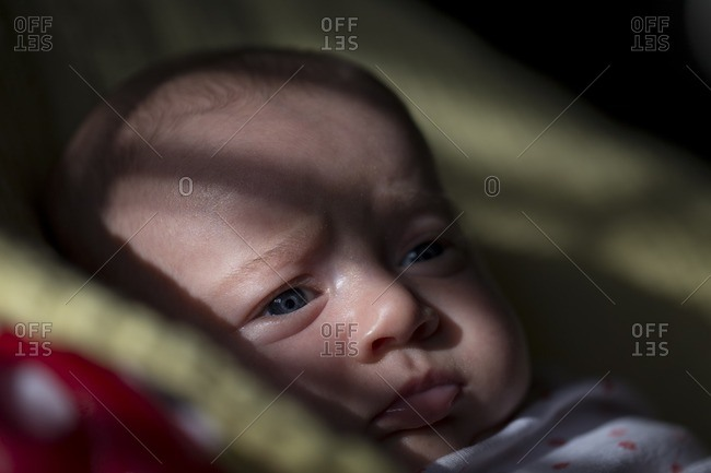 Light on face of little baby