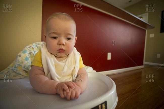 Baby looking sad in walker toy
