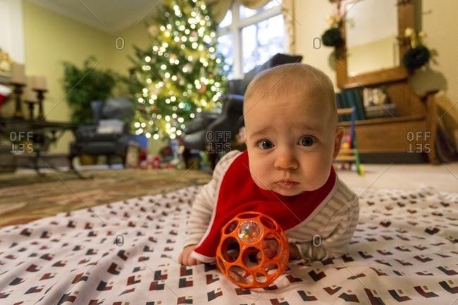 Baby on blanket at Christmastime