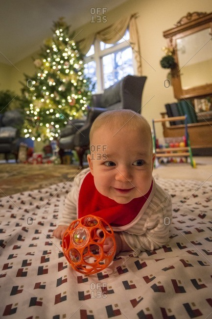 Baby on a blanket at Christmastime