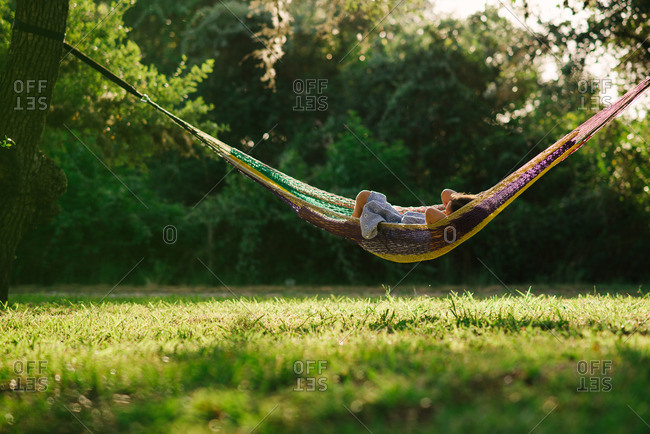 Child in hammock in sunlight