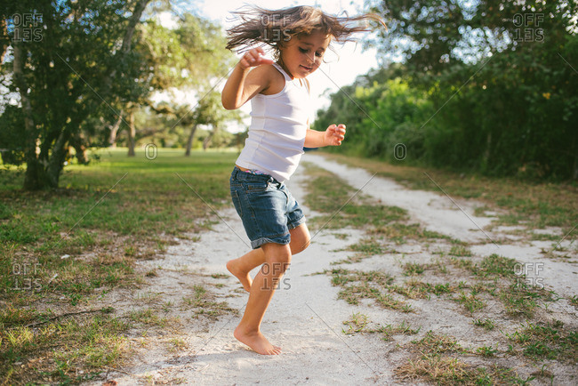 Girl jumping on rural path