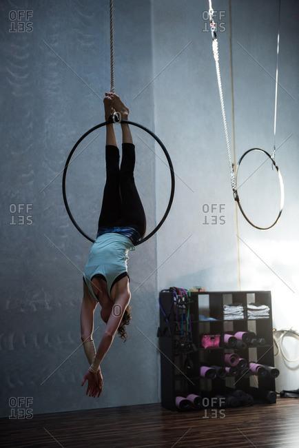 Gymnast performing gymnastics on hoop