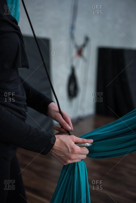 Gymnast holding fabric rope