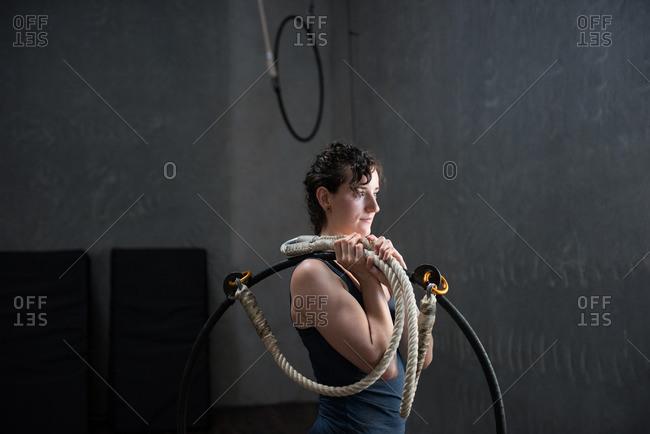 Gymnast holding gymnastics hoop - Offset