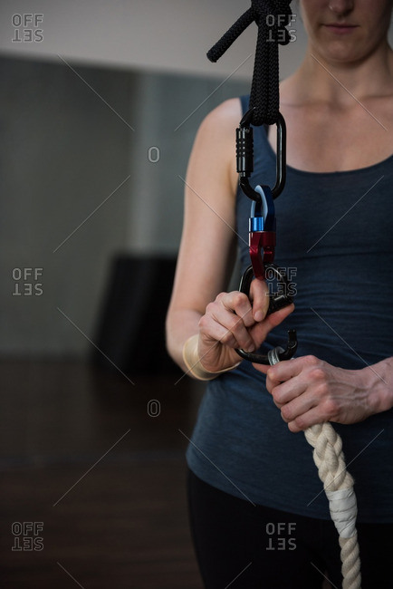 Gymnast attaching harness on rope