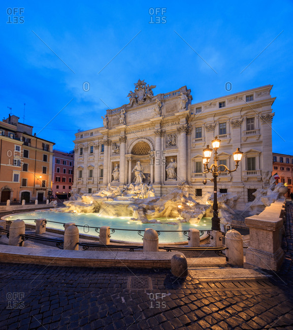 August 3, 2016: Panorama of Trevi Fountain illuminated by street lamps and the lights at dusk, Rome, Lazio, Italy, Europe