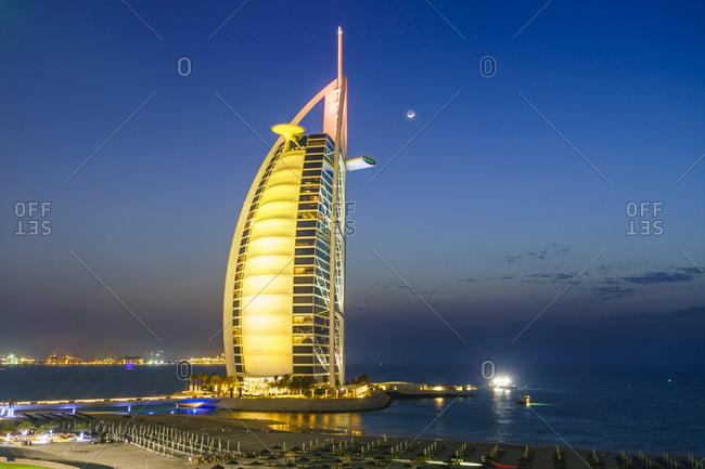 April 9, 2016: Burj Al Arab hotel at night, iconic Dubai landmark, Jumeirah Beach, Dubai, United Arab Emirates, Middle East