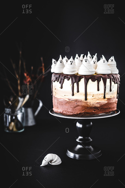 Spooky Ombre Halloween Cake With Fluffy Ghosts On Top Stock