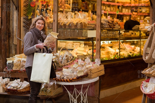 Woman in front of deli