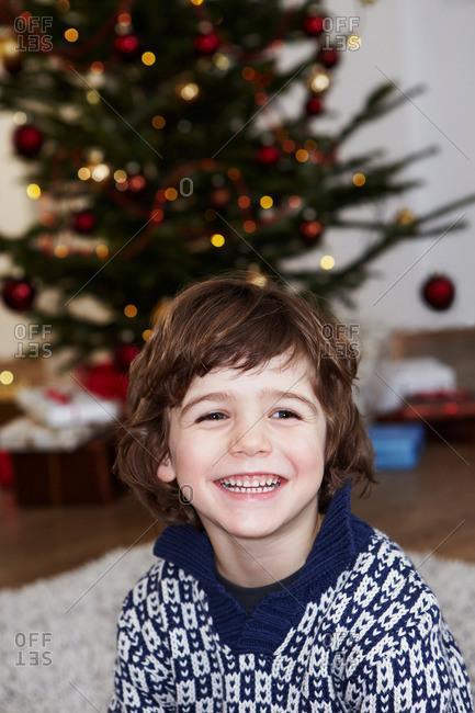Boy in front of xmas tree