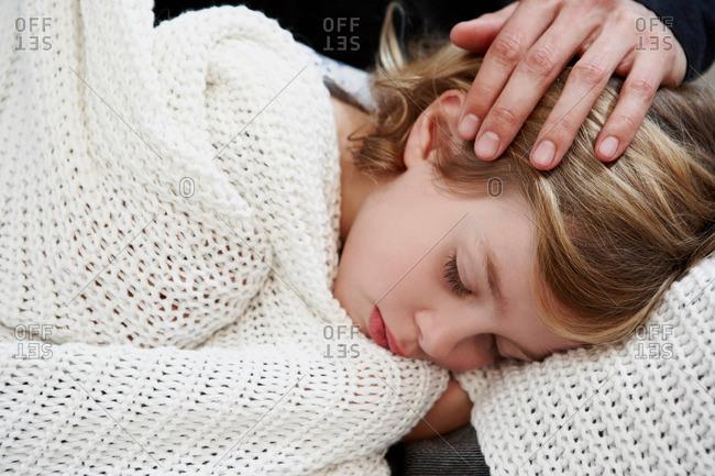 Girl sleeping under blanket