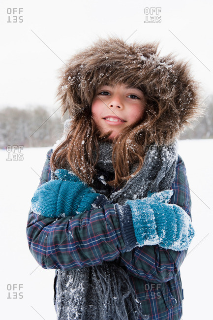 Girl standing in snow freezing