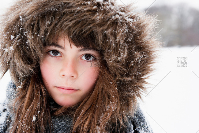 Girl with fur cap looking to camera