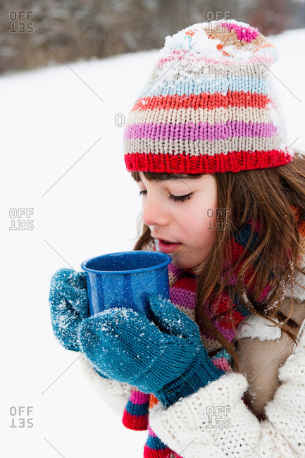 Girl having hot drink