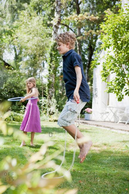 Two kids enjoying themselves in garden