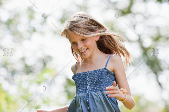 Girl running in garden
