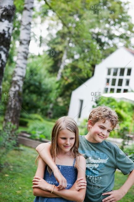 Boy hugging girl in the garden