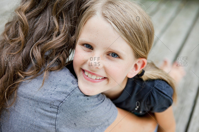 Girl happily hugging her mother