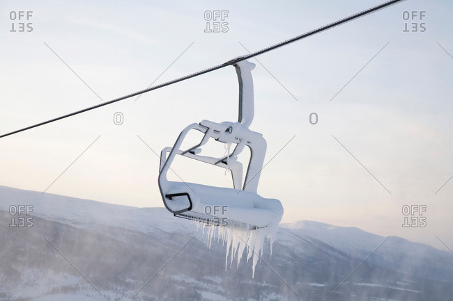 Chair lift full of snow and ice