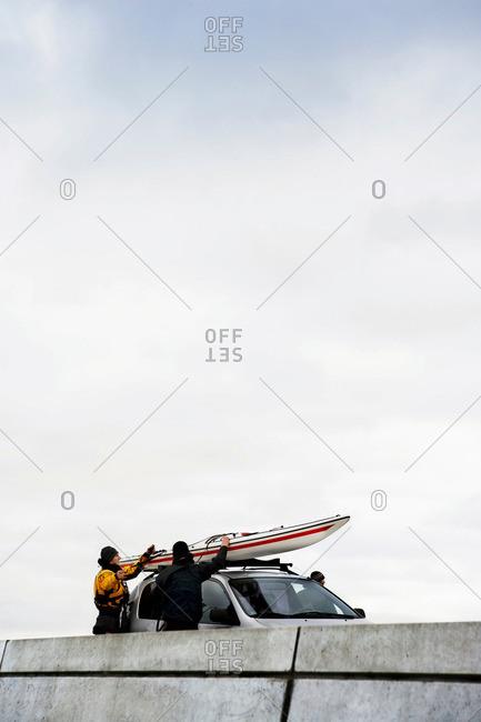 Unloading kayak