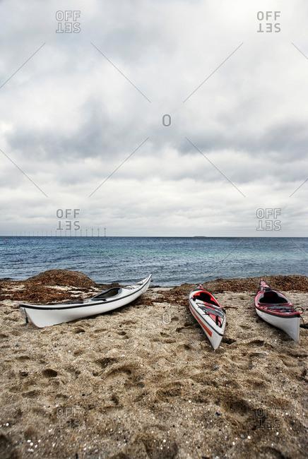 3 kayaks on beach