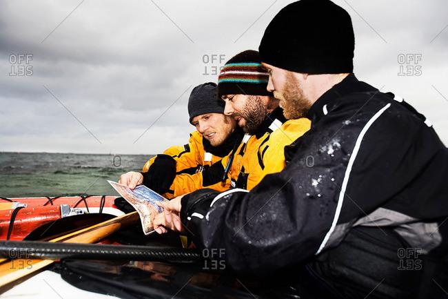 3 men looking at map