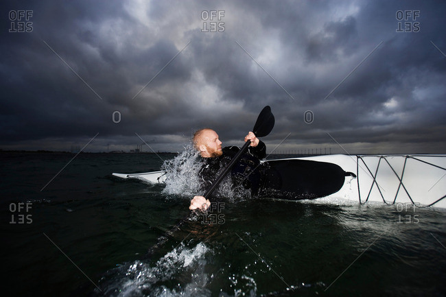 Man in kayak rotating
