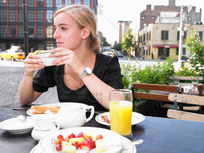 Woman having breakfast at a restaurant