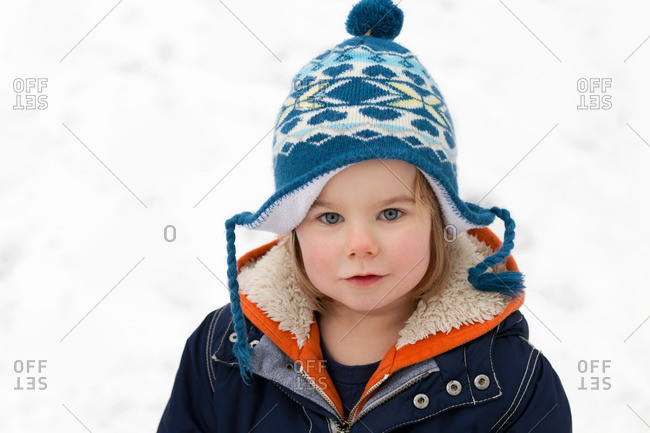 A portrait of a boy in the snow