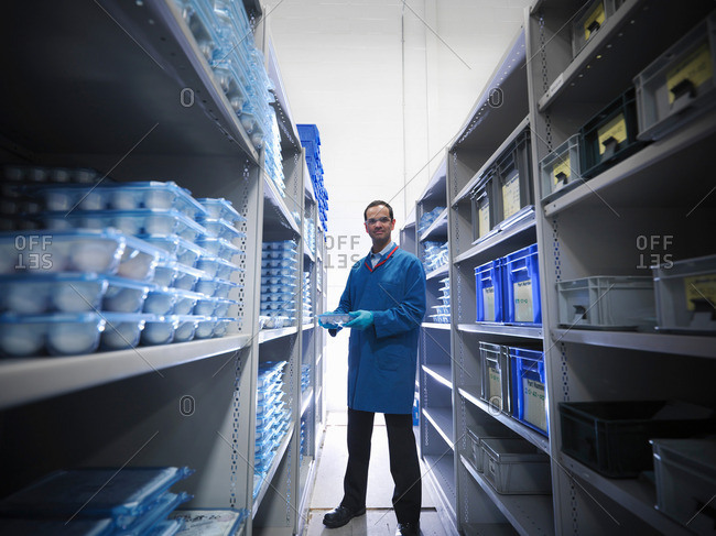 Male worker in storeroom