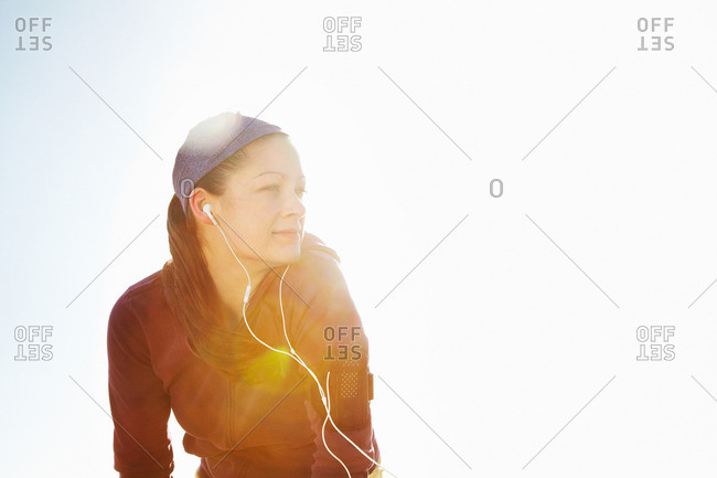 Portrait of sporty woman with lens flare