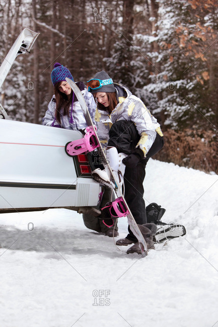 Teen girls going snowboarding