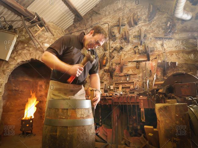 Worker making barrel in cooperage