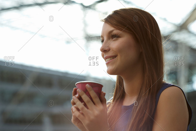 Woman with coffee cup smiling