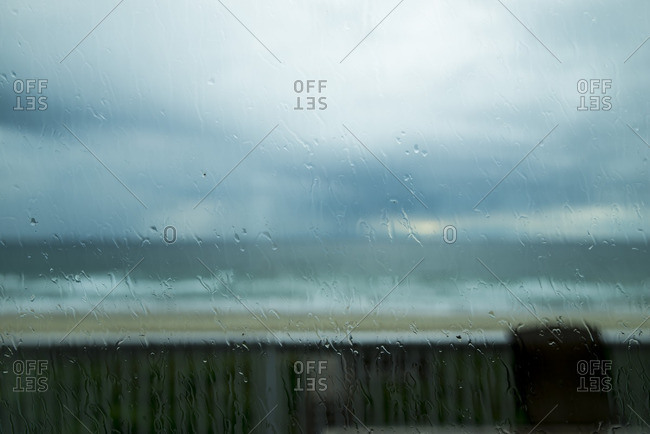 View of beach through a window of oceanfront home
