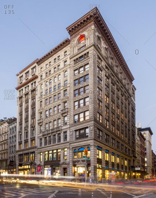 afc39461 New York, NY - August 27, 2015: Street view at dusk of building in SoHo  stock photo - OFFSET
