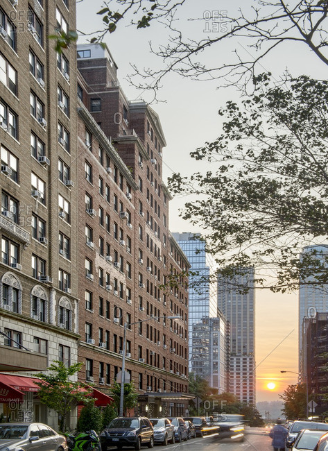 The sun sets on a city street in the Upper West Side of Manhattan