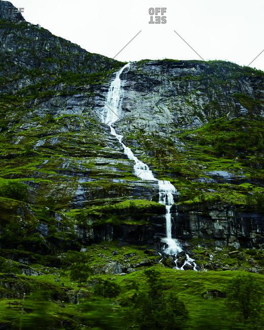 Waterfall along a mossy mountainside