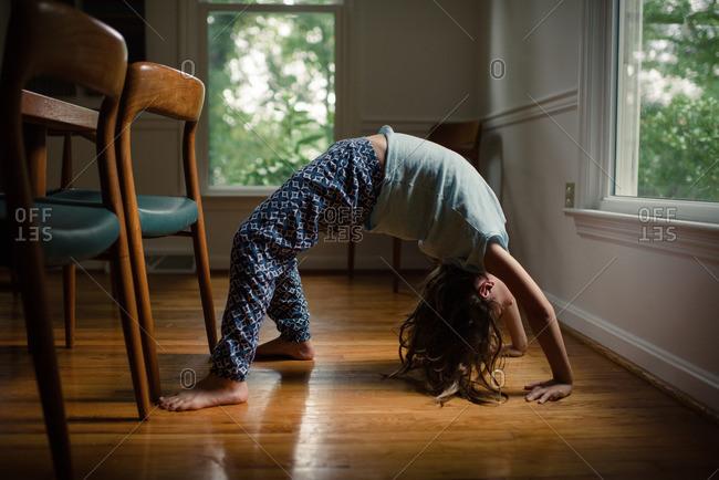 Little girl doing backbend