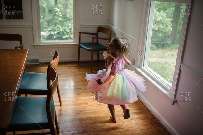 Little girl spinning in a colorful dress