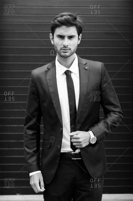 Portrait of a businessman standing against building