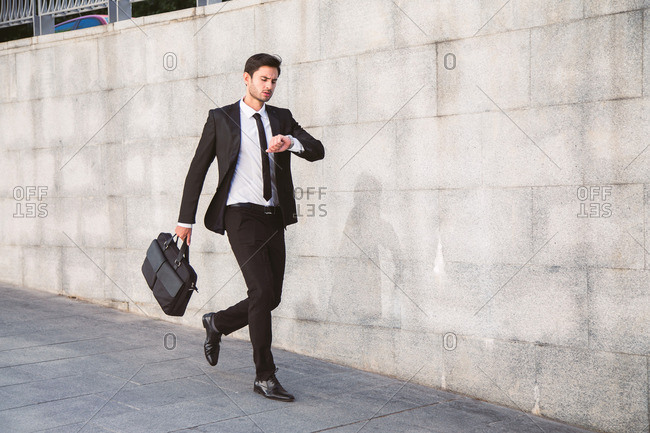 Businessman in a hurry checks his watch