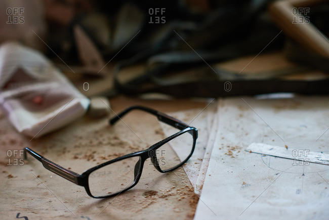 Glasses on a dusty table in a carpenter's workshop