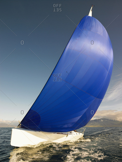 Sailboat tipping in wind