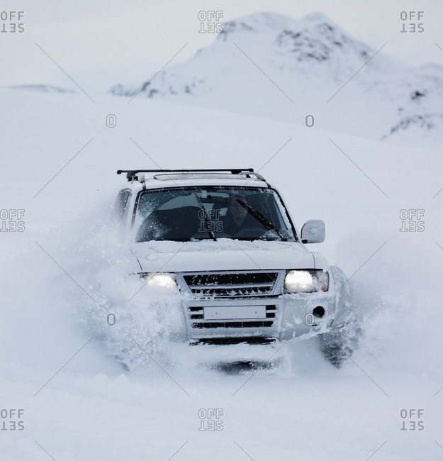 Couple driving SUV in snow
