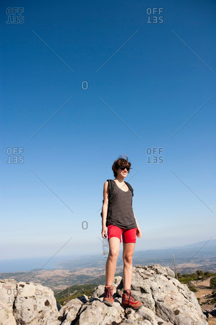 Hiker standing on rocks on hill