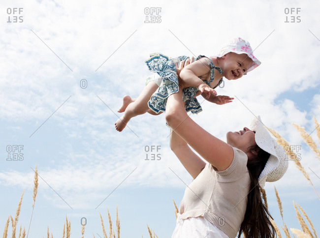 Woman playing with daughter outdoors