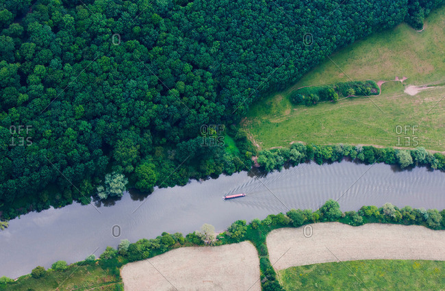 Aerial view of boat in rural river