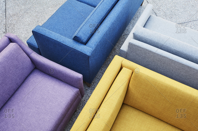 Close-up of sofas of different colors